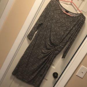 Black and white polka dot faux wrap dress
